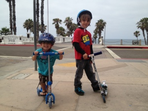 JJ and Kanan stopping their skooter session so Mom could take a picture. JJ was so excited!