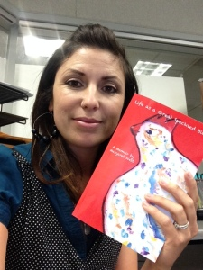 Theresa Hemsath holds the copy of the memoir Life as a Speckled Bird