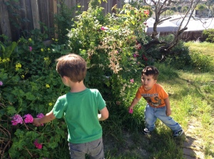 kids find flowers as a sign of spring and remember that Jesus is alive