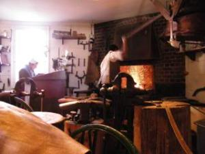silversmith sweats over his fire